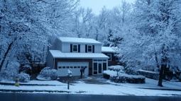 Ons huis in de sneeuw