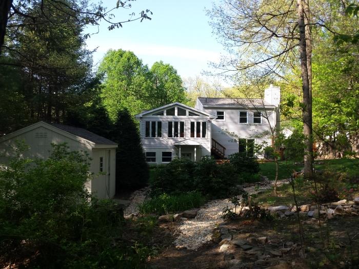 Ons huis van achter in de tuin gezien